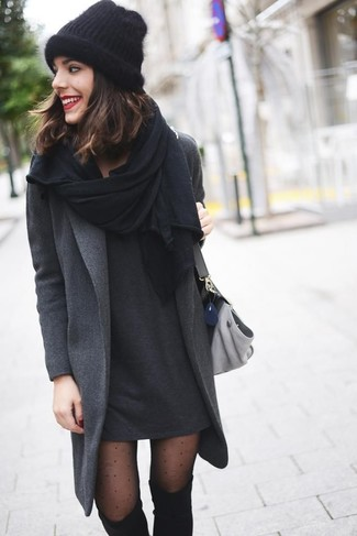 Let everyone know that you know a thing or two about style in a dark grey coat and a dark grey casual dress. Black suede over the knee boots will add a touch of polish to an otherwise low-key look.