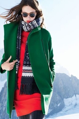 Pairing a green coat with a red casual dress is a comfortable option for running errands in the city.