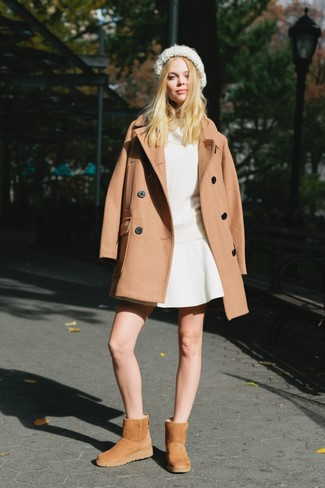 Camel Coat Outfits For Women: When you need to go about your day with confidence in your look, wear a camel coat and a white skater skirt. Wondering how to round off? Introduce tan uggs to the mix to mix things up a bit.