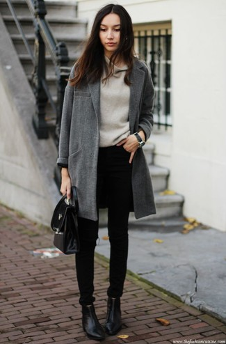 Wear a dark grey coat and black skinny jeans for an effortless kind of elegance. Black leather ankle boots are a smart choice to complete the look.