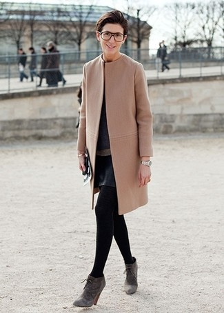 Try teaming a camel coat with a black leather a-line skirt for a work-approved look. Grey suede booties look awesome here. A comfortable transition ensemble like this one makes it super easy to welcome the new season.