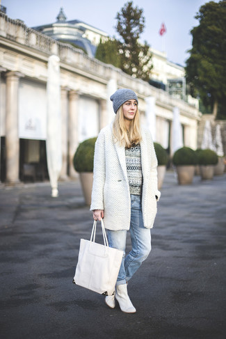 Stand out among other stylish civilians in a monochrome crew-neck sweater and light blue boyfriend jeans. Elevate your getup with white leather ankle boots.