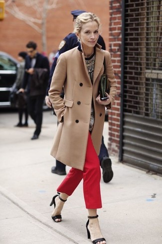 How to wear: camel coat, black print crew-neck sweater, red chinos, black leather heeled sandals