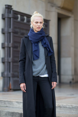 How to wear: black coat, grey crew-neck sweater, white crew-neck t-shirt, black skinny jeans