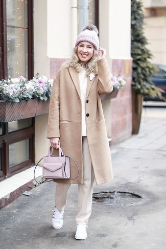 How to wear: camel coat, beige crew-neck sweater, beige dress pants, white leather low top sneakers