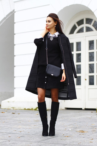 Reach for a black coat and a black button skirt for a lazy day look. Elevate this ensemble with black suede knee high boots.