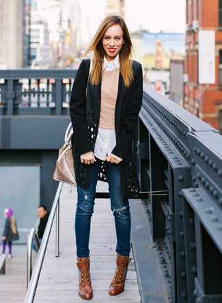 How to wear: black cutout coat, tan crew-neck sweater, white vertical striped dress shirt, blue ripped skinny jeans
