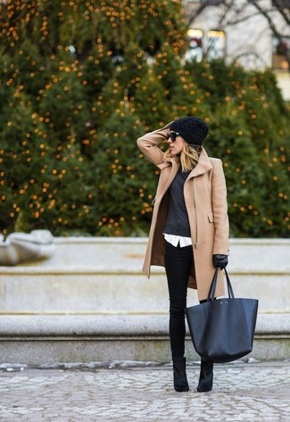 Make a tan coat and black slim jeans your outfit choice for both chic and easy-to-wear look. Black suede ankle boots are a smart choice to complete the look.