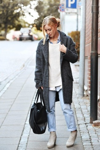 Try pairing a beige crew-neck sweater with baby blue boyfriend jeans to effortlessly deal with whatever this day throws at you. Grey suede ankle boots will bring a classic aesthetic to the ensemble.