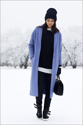 Consider teaming a blue coat with black skinny jeans to achieve a chic look. Opt for a pair of black leather high top sneakers for a more relaxed feel.