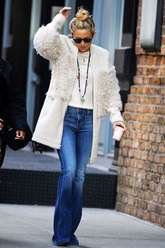 How to wear: white fleece coat, white crew-neck sweater, blue flare jeans, black suede ankle boots