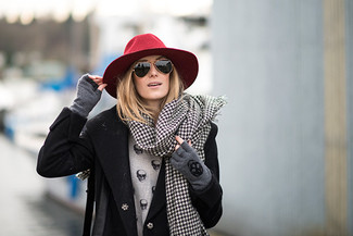 Wear a black coat with gloves for a sleek elegant look. A kick-ass getup that transitions easily into fall like this one makes it super easy to embrace the new season.