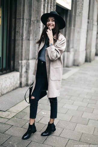 How to wear: grey coat, navy crew-neck sweater, black ripped jeans, black leather chelsea boots