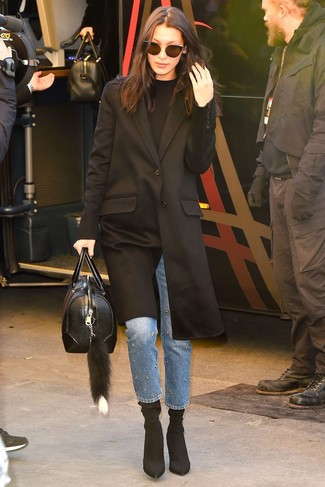How to wear: black coat, black crew-neck sweater, blue embellished jeans, black elastic ankle boots