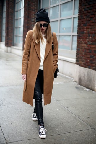 A tobacco coat and black leather leggings will give off this very sexy and chic vibe. A pair of navy low top sneakers will seamlessly integrate within a variety of outfits.
