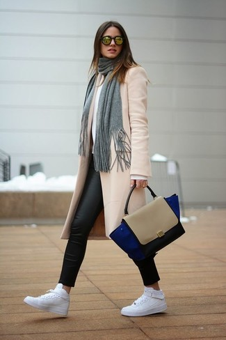 How to wear: beige coat, white crew-neck sweater, black leather leggings, white leather high top sneakers