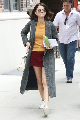 How to wear: grey plaid coat, orange crew-neck sweater, burgundy suede mini skirt, white canvas low top sneakers