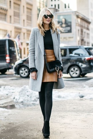 How to wear: grey coat, black crew-neck sweater, tan leather mini skirt, black suede ankle boots