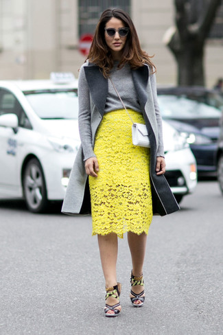 Tap into refined, elegant style with a grey coat and a yellow lace pencil skirt. Finish off your look with multi colored print leather heeled sandals.