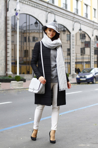 Step up your off-duty look in a black coat and white slim jeans. Round off this look with black suede pumps.
