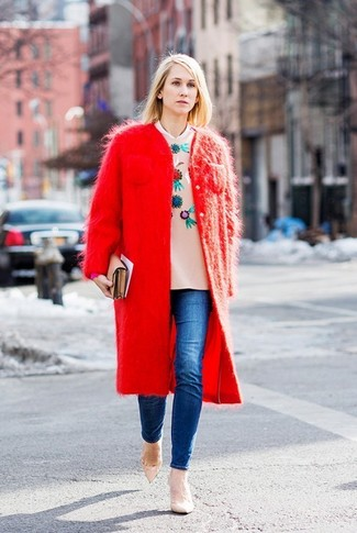 How to wear: red fluffy coat, beige embellished crew-neck sweater, blue skinny jeans, beige leather pumps