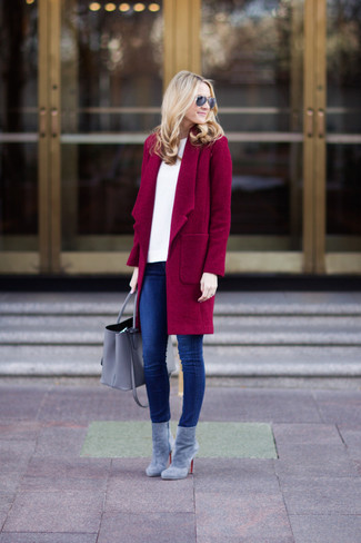 Consider pairing a dark red coat with blue skinny jeans for a refined yet off-duty ensemble. A pair of grey suede ankle boots will seamlessly integrate within a variety of outfits.