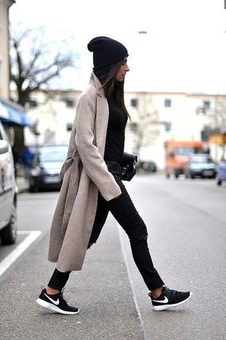 How to wear: beige coat, black crew-neck sweater, black ripped skinny jeans, black and white athletic shoes