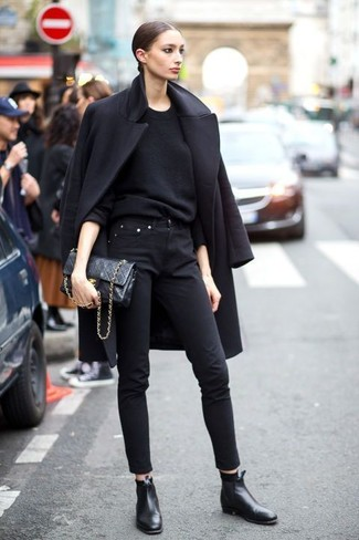 How to wear: black coat, black crew-neck sweater, black skinny jeans, black leather chelsea boots