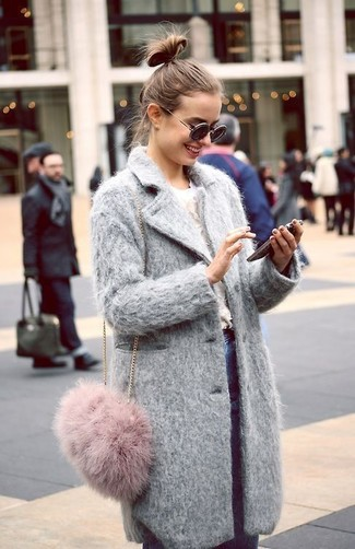 How to Wear a Pink Fur Crossbody Bag: Rock a grey coat with a pink fur crossbody bag to get a laid-back yet stylish look.