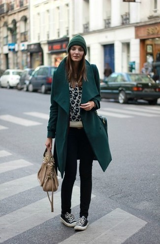 Pair a teal coat with a dark green beanie for a seriously stylish look. Make black low top sneakers your footwear choice for a more relaxed aesthetic. When it comes to dressing for unpredictable fall weather, nothing beats a kick-ass ensemble that transitions easily between seasons.