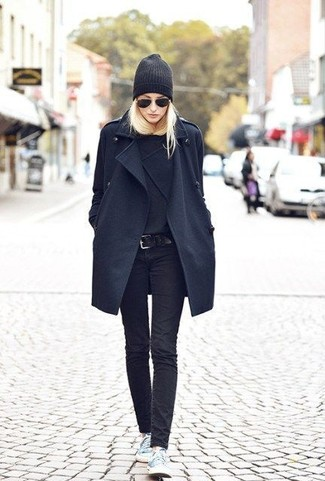 Women's Black Coat, Black Crew-neck Sweater, Black Skinny Jeans, Light Blue Low Top Sneakers