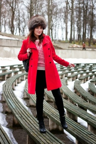 Marry a red coat with black skinny jeans for an effortless kind of elegance. This outfit is complemented perfectly with black leather ankle boots.