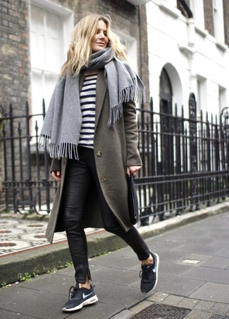How to wear: olive coat, white and black horizontal striped crew-neck sweater, black leather skinny pants, black and white athletic shoes