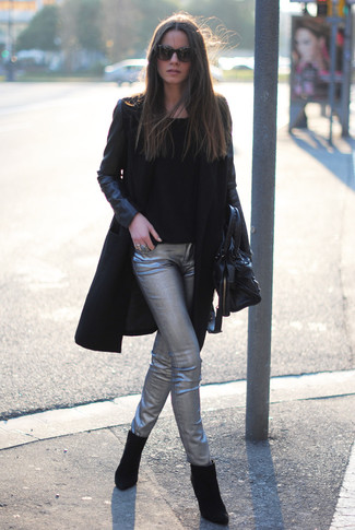 A black leather coat and silver leather skinny pants are appropriate for both smart casual events and day-to-day wear. Look at how well this look goes with black suede ankle boots. Seeing as temperatures are dropping, this outfit appears a savvy pick for in between seasons.
