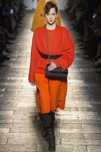 How to wear: orange coat, orange crew-neck sweater, black skinny pants, black leather ankle boots