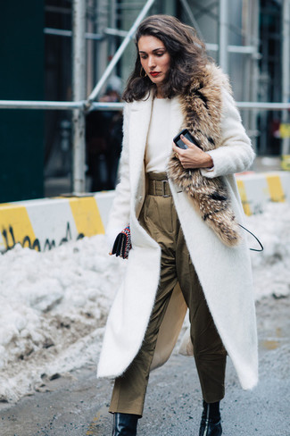 How to wear: white textured coat, white crew-neck sweater, olive silk tapered pants, black leather ankle boots
