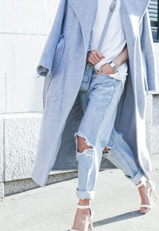 Team a baby blue coat with baby blue destroyed boyfriend jeans and you'll look like a total babe. Opt for a pair of white heeled sandals to va-va-voom your outfit.