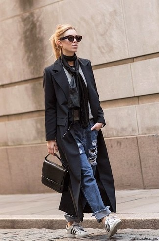 How to wear: black coat, grey crew-neck t-shirt, blue ripped boyfriend jeans, white and black leather low top sneakers