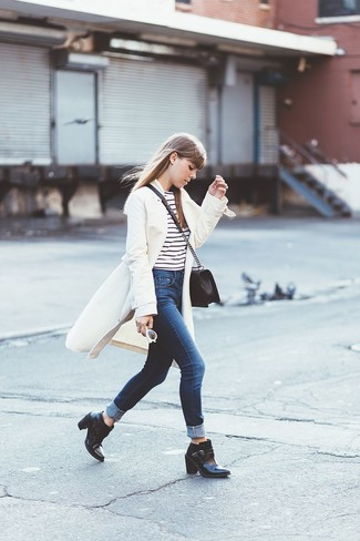 How to wear: white coat, white and black horizontal striped crew-neck t-shirt, navy jeans, black leather ankle boots