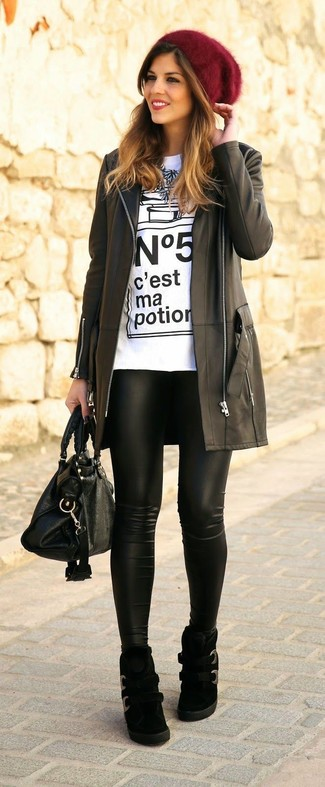 How to wear: black leather coat, white and black print crew-neck t-shirt, black leather leggings, black suede wedge sneakers