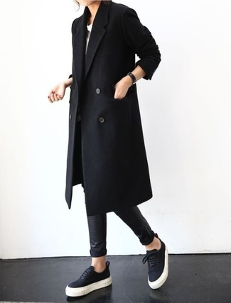 To create an outfit for lunch with friends at the weekend rock a black coat with black leather leggings. Round off this outfit with black low top sneakers. Mastering transitional fashion is easy with style inspiration like this.