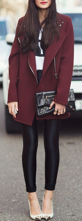 Effortlessly blurring the line between chic and casual, this combination of a dark red coat and black leggings is likely to become one of your favorites. White leather pumps will bring a classic aesthetic to the ensemble.
