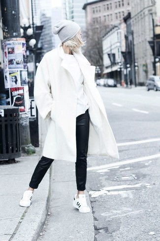 How to wear: white coat, white crew-neck t-shirt, black leather pajama pants, white and black low top sneakers