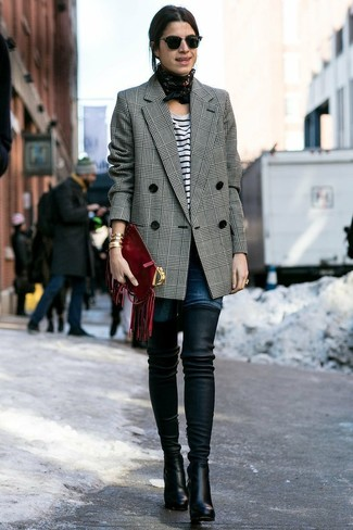 If you're a fan of classic pairings, then you'll like this combination of a grey plaid coat and dark blue slim jeans. A pair of black leather over the knee boots looks proper here. This combo is super comfortable and will help you out in transitional weather.