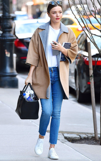 How to wear: camel coat, white crew-neck t-shirt, blue skinny jeans, white low top sneakers