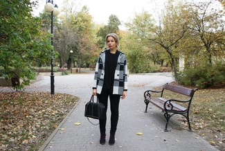 Effortlessly blurring the line between chic and casual, this combination of a black and white plaid coat and black slim jeans is likely to become one of your favorites. Black suede wedge sneakers are the right shoes here to get you noticed.
