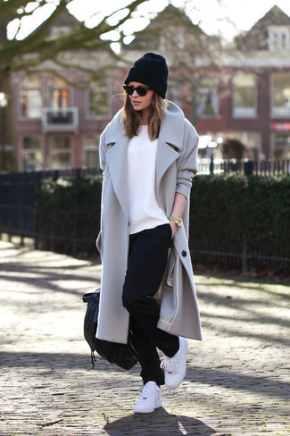 A grey coat and black running pants is a savvy combination to add to your styling repertoire. Why not add white trainers to the mix for a more relaxed feel?