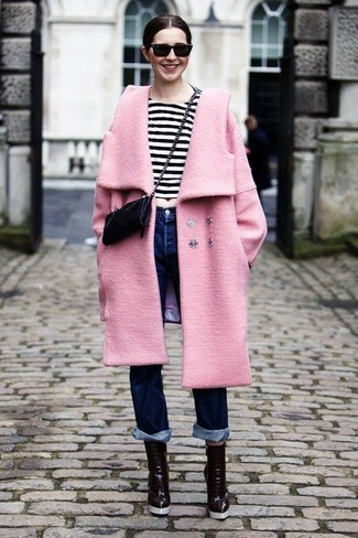How to Wear Tobacco Leather Ankle Boots In Summer: Dress in a pink coat and navy jeans for a killer and fashionable outfit. Look at how great this ensemble goes with a pair of tobacco leather ankle boots. This here is proof that one actually can survive the oppressive heat, all while looking fresh and breezy.