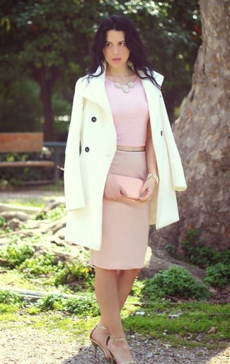 Make a white coat and a pink pencil skirt your outfit choice for a work-approved look. Balance this getup with gold leather heeled sandals. This outfit has all the potential to become your hot weather go-to.