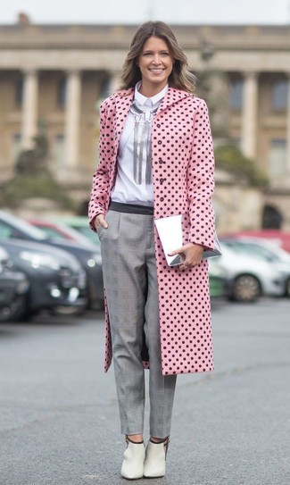 Pairing a pink polka dot coat with an Isabel Marant Silver Rich Choker is a comfortable option for running errands in the city. Complete this look with beige cutout leather ankle boots. This combination is a great option come warmer days.